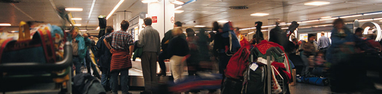 photo of people waiting on baggage